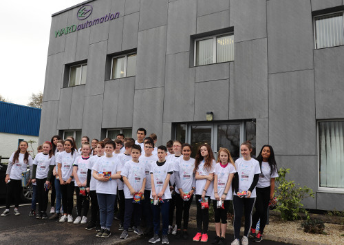 Students from St Macartans NS outside Ward Automation